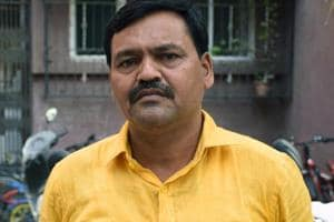 The Bazarpeth police booked Mohan Ugale for assaulting a man who along with his mother was protesting against him.