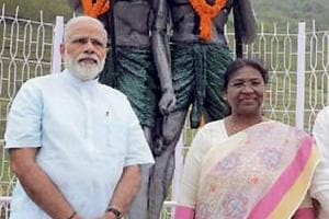 A file picture showing Prime Minister Narendra Modi along with Jharkhand governor Droupadi Murmu and chief minister Raghubar Das in Sahibganj in April. The BJPgovernments in the state and the Centre have come under attack from tribals, and appointing Murmu as President could help win back their support.