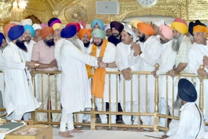 Punjab chief minister being given 'siropa' inside the sanctum sanctorum of Golden Temple, Amritsar, on Monday.