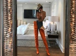 Model Kendall Jenner flaunted waist-high boots on her Instagram page.