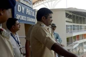 A police inspector surveys DY Patil stadium ahead of Bieber's show on Wednesday.