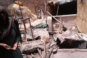 A Dalit woman in Shabbirpur village in Saharanpur stands among the ruins of her house allegedly destroyed by a Thakur mob on May 5.