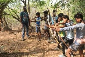 "Tribals aiming on wild animals with their traditional weapons during  ""Sendra "" ( annual hunting festival of trbals) at Dalma forest in Jamshedpur"