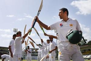 Members of the Pakistan cricket team form a guard of honour for Younis Khan, who was dismissed for 35 after batting for the last time before retirement on Day 4 of the third and final Test against the West Indies cricket team at Windsor Park Stadium in Roseau, Dominica, on Saturday.