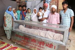 Family members with the dead body Jaswant in Lehra Bega village at Bathinda on Monday.