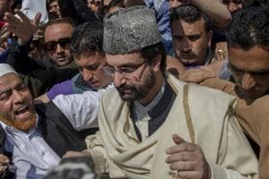 All Parties Hurriyat Conference Chairman Mirwaiz Umar Farooq, stands with supporters during a protest in Srinagar.