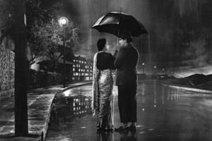 A still from the song 'Pyar Hua Ikrar Hua' in Shree 420. Written by Khwaja Ahmad  Abbas, the film feature a famously Chaplin-esque Raj Kapoor who plays a poor orphan in big, bad and rich Bombay.