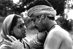 A still from Satyajit Ray's 1981 film, Sadgati, starring Om Puri (R) and Smita Patil (L).