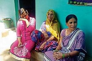 Chandabai Patel (R) with her mother-in-law Belabai and daughter Poonam at their house at Amarpur.