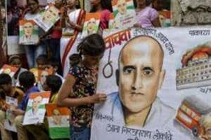 Students hold up painted posters of Kulbhushan Jadhav who was sentenced to death by a Pakistani military court.