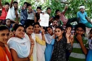 Rewari village girls rejoicing after the Haryana government issues notification to upgrade their village high school to senior secondary on Wednesday.