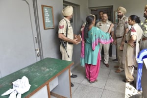The school caretaker giving details to the police in Amritsar on Friday.