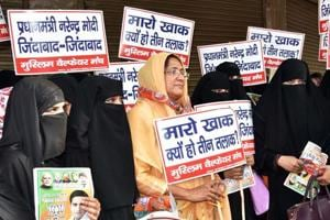 Muslim women hold placards against