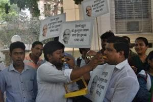 People with posters of Kulbhushan Jadhav celebrate the International Court of Justice's stay on his execution in Mumbai on Thursday.