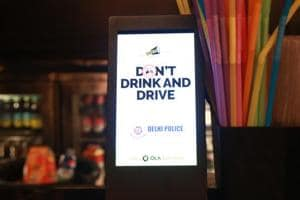 Delhi Police's new initiative against drunk driving takes the message to digital screens across several bars and pubs. Here's  a screen installed at the bar counter.