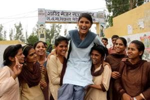 Girls celebrate after declaration of Class 10 results at Government Senior Secondary School Kheri Sadh in Rohtak on Monday.  Girls have outshined boys with a large margin.