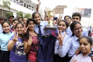 Students of class 10th in jubilant mood after the declaration of the result in Patiala on Monday.