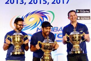 Mumbai Indians captain Rohit Sharma , Parthiv Patel and Shane Bond with Indian Premier League replica trophies.