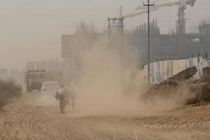 Top officials to work together to mitigate air pollution in Noida,...