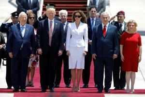 Video clip shows Melania Trump brushes away US President's hand during...
