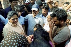 Bahujan Samaj Party chief Mayawati interacts with violence-hit people in Sabbeerpur village in Saharanpur district on Tuesday.