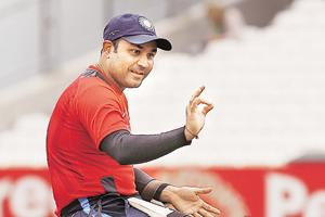 Virender Sehwag becomes Twitter crorepati, celebrates in signature...
