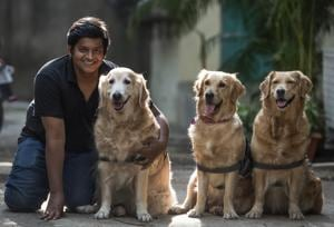 Aakash Lonkar, Mumbai head of Animal Angels Foundation, with his therapy dogs Pepe, Pearl and Sunshine.