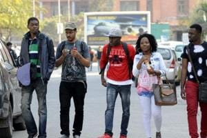 Offer African students scholarships, but assure them of safety also