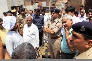 District officials and police interact with villagers in violence-hit Shabbirpur village of Saharanpur district on Thursday.