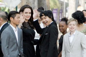 Angelina Jolie took daughter Shiloh to Disneyland while Brad Pitt was...