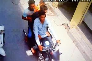 A CCTV grab of motorcycle-borne assailants kidnapping the child.
