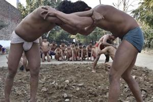 Munna Singh has kept his father's dreams alive and organises mud wrestling competition every year.