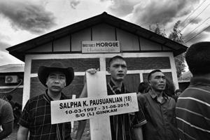 Manipur, India - May 24, 2017: After 632 days eight of the nine Tribal's, who were killed on August 31,2015 in Manipur's Churachandpur Town, were buried after an agreement between hill tribes and the Manipur Government. The bodies which were kept in the town's morgue for almost 2 years were finally laid to rest after a mourning ceremony at Churachandpur in Manipur , India, on Wednesday, May 24, 2017. (Photo by Ravi Choudhary/ Hindustan Times)