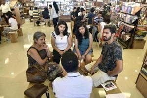 Readers listen to stories from people acting as human libraries at Title Waves, Bandra, on Sunday.
