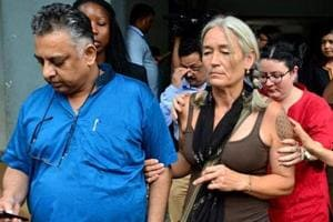 Fiona MacKeown, mother of Scarlett Keeling, leaves the court premises along with her lawyer Vikram Verma, left, in Panaji, Goa, Friday, Sept. 23, 2016.