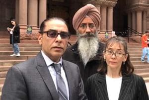 Gurpatwant Pannun, SFJ's legal advisor, Jatinder Singh Grewal, also of SFJ and Vanora Simpson, a lawyer with Goldblatt Partners, in front of the Ontario Superior Court building in Toronto