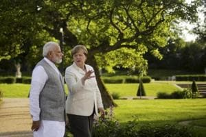 PM Modi meets Angela Merkel for informal talks at country retreat in...