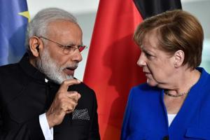 Modi told Merkel India will stick to climate accord even if US pulls...