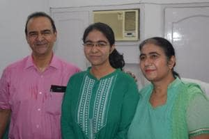 Saumya Pandey with her parents after declaration of UPSC results, in Allahabad on Wednesday evening.