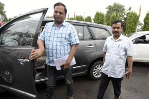 Delhi health and power minister Satyendar Jain (left) with Delhi Chief Minister Arvind Kejriwal in Delhi Assembly on Wednesday. The I-T department had attached assets of Jain in a case against him.