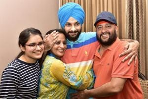 Anmol Sher Singh celebrates with his family at his resident in Amritsar.