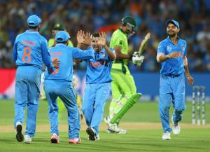 Mohammed Shami celebrates with his teammates after dismissing Wahab Riaz during the 2015 ICC Cricket World Cup match between India and Pakistan at Adelaide , 2015 .  The fanaticism around India versus Pakistan encounters has always been positive.