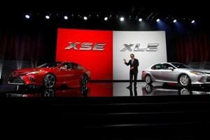 Akio Toyoda, president of Toyota Motor Corporation, introduces the 2018 Camry XSE (L) and the 2018 Camry XLE during the North American International Auto Show in Detroit in January.