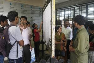 Students check a merit  list at a city college.