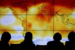 File photo of participants looking at a screen showing a world map with climate anomalies during the World Climate Change Conference 2015 (COP21) at Le Bourget, near Paris, France.