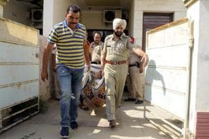 Policemen bringing out the body of Rajatvir Singh from his house in Darshan Nagar, Patiala, on Thursday, June 1.