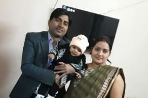 Pramod with his wife and kid.