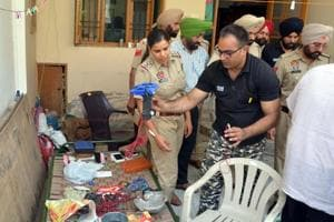 A bomb squad and cops checking material allegedly meant to make explosives at Rajatvir Singh Sodhi's house in Patiala on Friday, June 2.