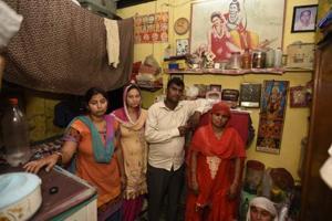 E-rickshaw driver Ravinder Kumar's familyat their house in JJ Cluster slum colony, GTB Nagar, on Friday.