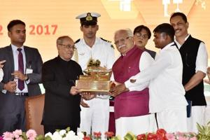 Haryana CM Manohar Lal Khattar presents a memento to President Pranab Mukherjee during the inauguration of Drivers' Training Institute and a government senior secondary school at Daula Village, Sohna, Gurgaon on Friday.